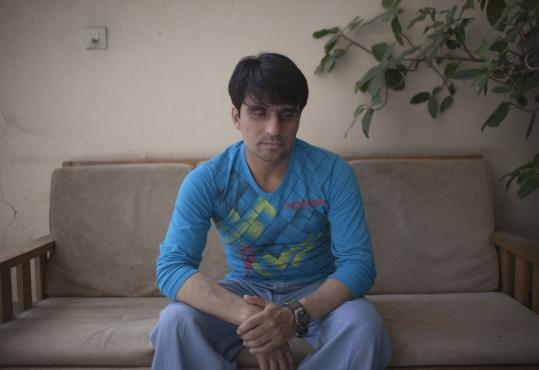 Afghan worker Abdul Tawab said his former boss, Bryan Rhodes, left Afghanistan last fall without paying local vendors. Tawab, who helped line up workers, said he has faced threats.