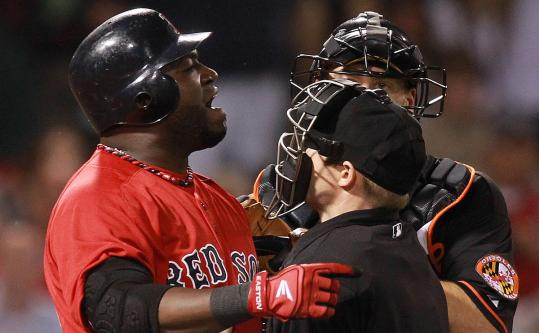 Umpire Mike Estabrook and Orioles catcher Matt Wieters get in David Ortiz's way during Friday's contentious eighth inning.