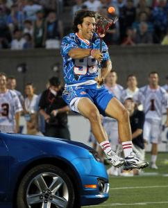 Paul Rabil had lacrosse fans in Harvard Stadium revved up by clearing a Ford Fusion during the MLL skills competition.