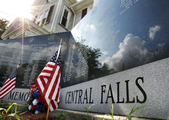 Major concessions are being sought from municipal workers of Central Falls, where flags had been planted at the city's memorial.