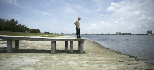 The drought has hit West Palm Beach, Fla., where this dock sits above a dried lake bed. The dock runs 60 feet from the shoreline.