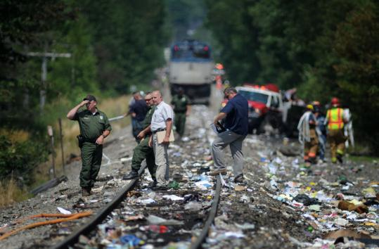 Trash was strewn over the tracks as investigators pored over the scene after a truck was struck by an Amtrak passenger train yesterday in North Berwick, Maine.