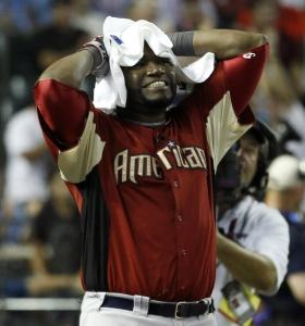 David Ortiz reacts to a home run by the Brewers' Prince Fielder, but both players were ousted after the second round.