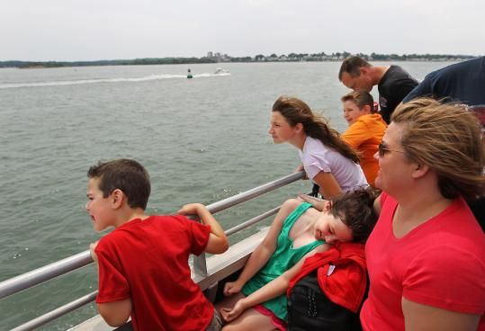 Julie DuPuis (right) of Plymouth and her children, Jake, 6, and Madison, 8, enjoy the ferry ride from Fore River Shipyard in Quincy to Georges Island.