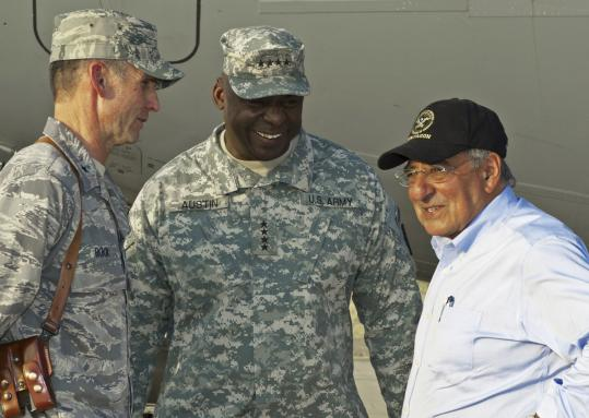 Leon Panetta, right, chats with generals Anthony Rock, left, and Lloyd Austin.
