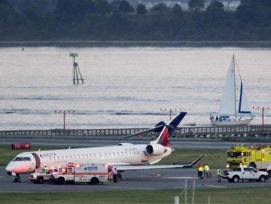 An Atlantic Southeast jet sat at Logan Airport last night with a damaged tail, after being hit by larger jet.