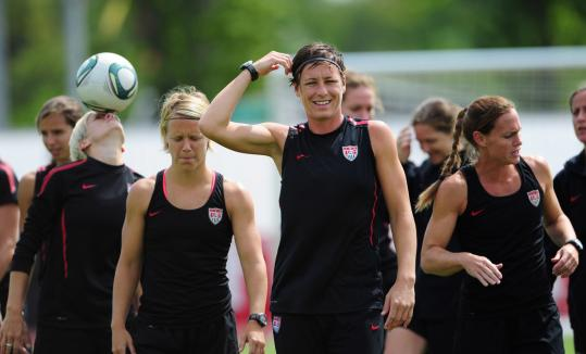 US striker Abby Wambach (center) and her teammates have been on the ball as they prepare for tomorrow&#8217;s World Cup final.