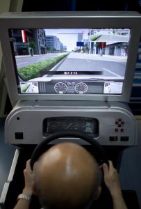 Dr. Jin Huiqing in a driving simulator similar to the ones used by drivers who are tested by his company.