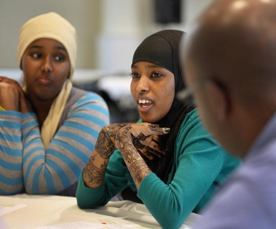Shadiyo Hussain of Portland, Maine (left) and Amal Ahmed of Charlestown spoke at the conference yesterday of their experiences growing up in New England.