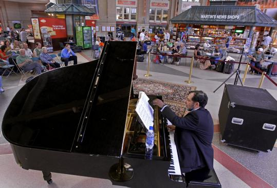 Pianist Bruce Lewis gave his weekly performance at South Station last week. Operators look to add more cultural events.