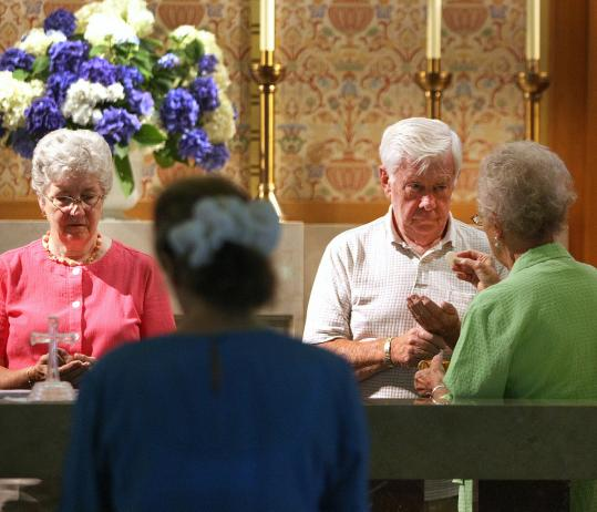 St. James the Great parishioners held their weekly prayer service yesterday in Wellesley. The church is among those the archdiocese has decided to sell.