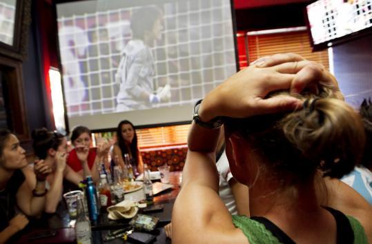 Rebecca Abbott of Medford held her head in Cambridge as she watched Ayumi Kaihori save a US shot in Frankfurt.