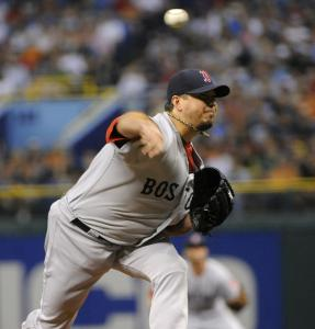Recovered from a mildly hyperextended knee, Josh Beckett delivers to the Rays in the first.