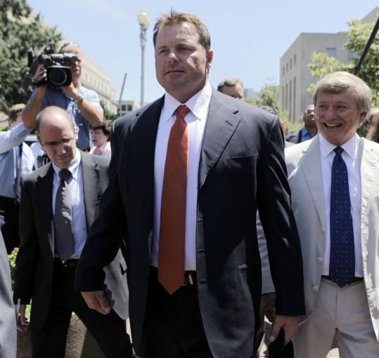 Roger Clemens, center, left the federal courthouse in Washington last week with attorney Rusty Hardin after a judge declared a mistrial in the former Red Sox star's perjury trial.