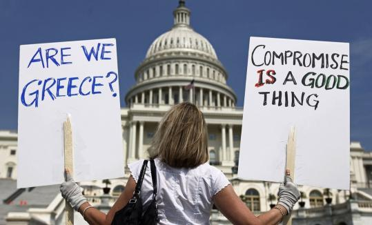 A demonstrator held signs in front of the Capitol building in Washington to protest debt in the United States.