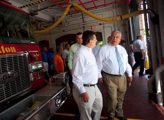 Councilor Mark Ciommo (left) and Mayor Thomas M. Menino attended the ribbon-cutting ceremony yesterday to reopen the Engine 51 firehouse in Brighton.