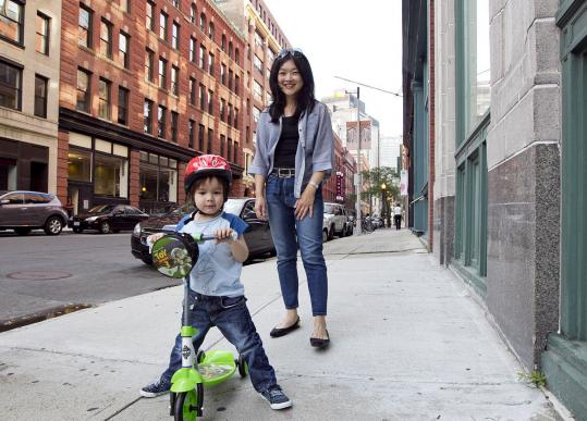 Virna Chan, with her 3-year-old son, Vytas Chan Budris, calls the Leather District home. The district, which Chan characterizes as hip and young, consists of three streets between South Station and Chinatown.
