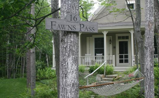 On Fawns Pass, a cottage at the forested Hidden Pond resort in Kennebunkport, a mile inland from the ocean.