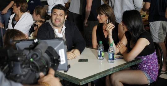 Adam Richman with some customers at JP's Eatery.