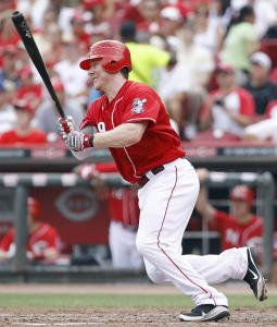 The Reds' Ryan Hanigan singles Sunday against St. Louis.