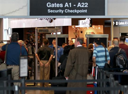 Scanner images caused a public uproar last year, but new software being installed on millimeter wave machines shows a silhouette of the person being scanned. Here, passengers went through security at Logan Airport in August 2010.