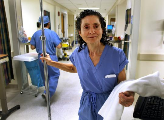 'There are many people who continue to work into their 80s ... I want to work as long as I'm physically able,' said Roxane Larouche, 64, an operating room nurse at Beth Israel Deaconess Medical Center.