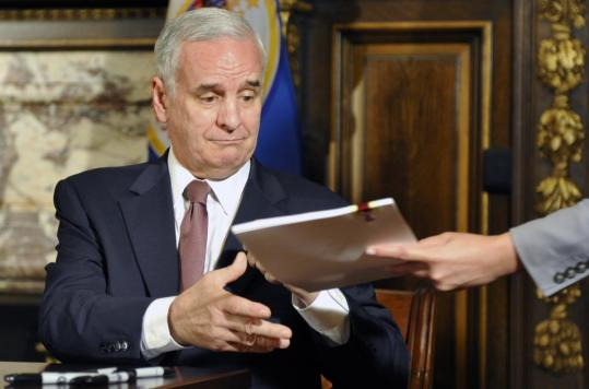 A 20-day Minnesota government shutdown ended when Governor Mark Dayton signed a compromise two-year spending plan. Some 22,000 state workers had been idled.