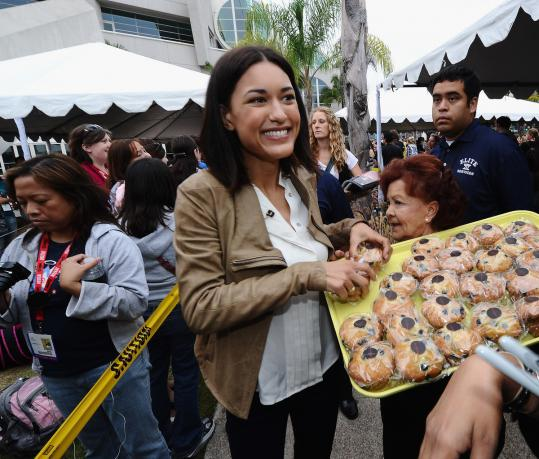 "Julia Jones serves snacks to ""Twilight'' fans in San Diego."