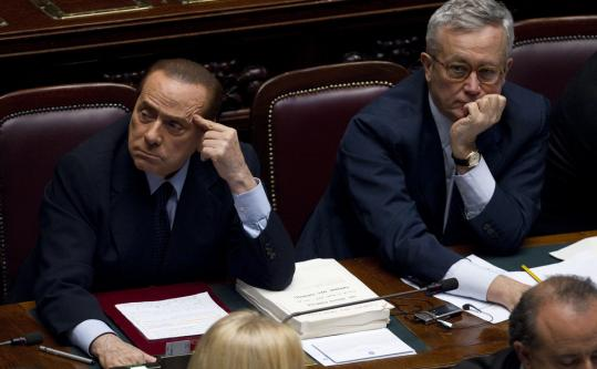 Italian Premier Silvio Berlusconi (left) and Finance Minister Giulio Tremonti voted a week ago over a crucial $100 billion austerity package. Tremonti, who devised the austerity plan, had warned his colleagues that politicians had to set the example if they were to be credible in demanding sacrifices of ordinary Italians.
