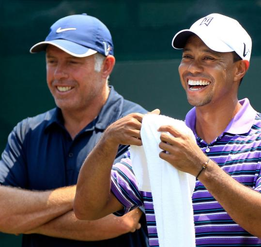 Though they looked chummy in May, caddie Steve Williams (left) said he had been feeling out of touch with Tiger Woods.