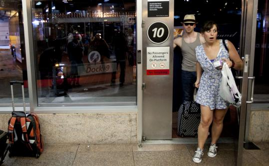 Lindsey Sedlack and Ben Berkowitz entered South Station bus terminal yesterday evening after their hot ride from New York.
