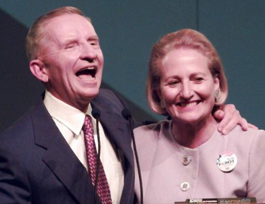 Ross Perot laughs with his wife, Margot Birmingham, after addressing the Reform Party convention in Pennsylvania in 1996.