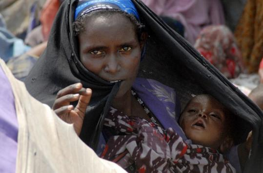 A Somali mother waited for aid at a refugee camp yesterday in Mogadishu, where an ongoing civil war rages. The country's prolonged drought has devolved into famine.