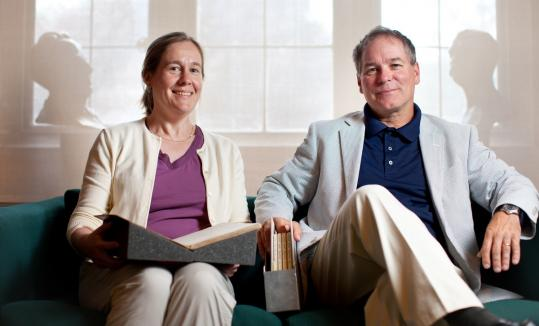 "Boston College librarians Betsy McKelvey and Tom Wall with the five notebooks that contain ""Love and Death,'' the first play written by Yeats."
