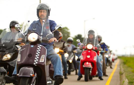 Danny Kourafas, owner of an Avon scooter shop, led a group of scooter enthusiasts on a group ride along the South Shore on a recent Sunday.