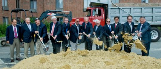 Dignitaries, including Braintree Mayor Joseph C. Sullivan (sixth from right) line up to shovel dirt at last Tuesday&#8217;s groundbreaking for a new Hyatt hotel in Braintree.