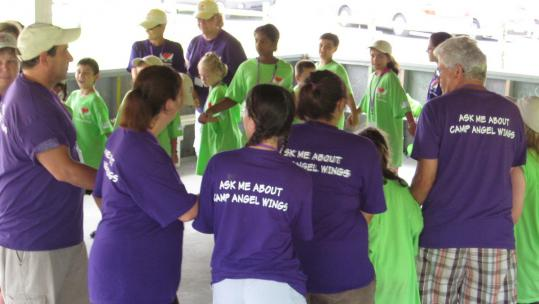 Volunteers and campers last year at Camp Angel Wings, a bereavement camp for kids. It will take place in Freetown next weekend.