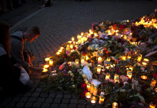 People created a memorial outside the Oslo cathedral yesterday to honor victims of the twin attacks. A massive bombing in the capital was followed by a shooting spree on an island.