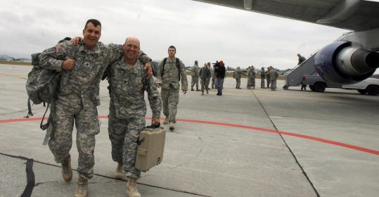Sergeant Jared Doohen, left, and Staff Sergeant Thomas Stanley return home to Vermont last year after nine months in Afghanistan.