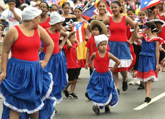 Dressed in the colors of the flag of the commonwealth of Puerto Rico, the Fuerza International Dance Group marched near the front during the Puerto Rican Day Parade along Columbus Avenue in Roxbury yesterday.