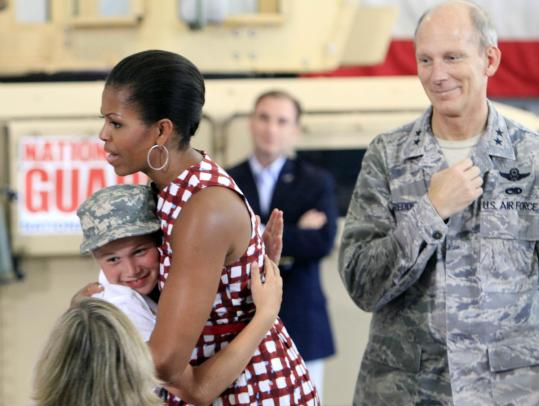 Michelle Obama hugged Liam Bennett during a cookout for National Guard members and families in Concord, N.H.
