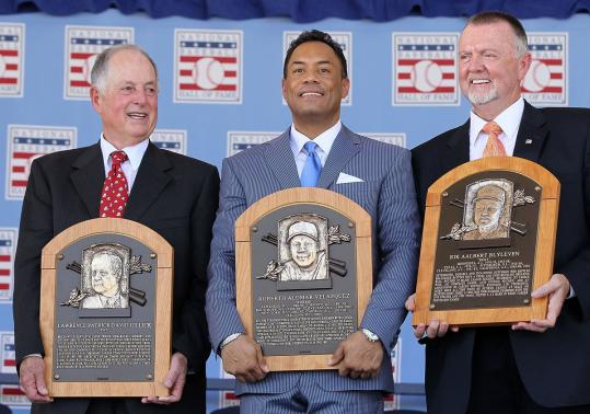 Inductees (from left) Pat Gillick, Roberto Alomar, and Bert Blyleven show off their Hall of Fame plaques after the ceremony.