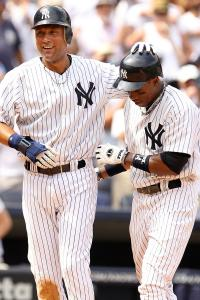 Yankees&#8217; Curtis Granderson (right) receives kudos from Derek Jeter after Granderson&#8217;s two-run homer in the fifth.