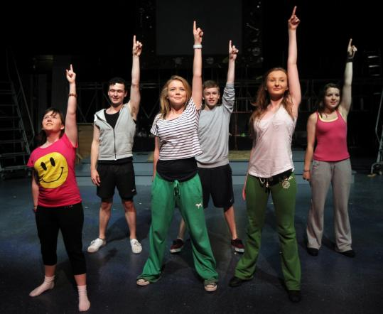 "From left: Emily Bradley, Alan Dean, Ailbhe Casey, Kevin O'Dwyer, Sarah-Kate Fanning, and Alice Stubbs at a ""Fame'' rehearsal in Natick."