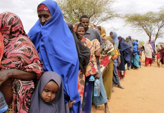 On Sunday, women lined up for World Food Program emergency distributions in Dolo, Somalia.