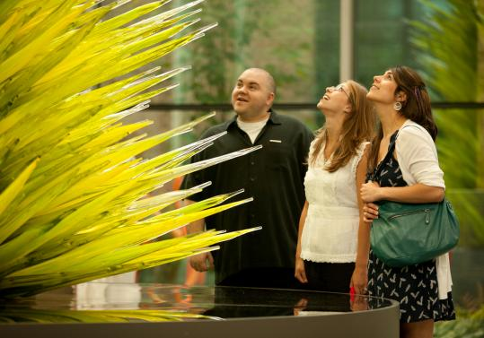 "Museum of Fine Arts patrons Derek Scholl, Jamie Rossetti, and Jackie Burns stared up at ""Lime Green Icicle Tower.''"