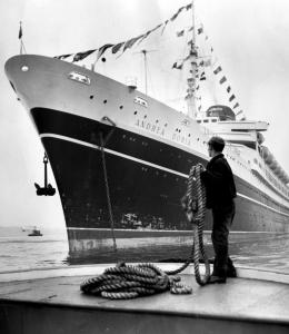 In New York, a deckhand stood near the Andrea Doria in 1953. Sixteen divers have died while exploring the ship's remains.