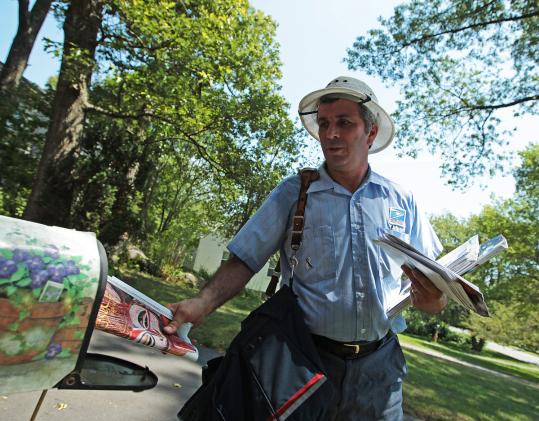 Domenic Corsetti delivered mail on his Lexington route Friday as temperatures climbed into triple digit