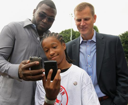 From left: David Ortiz, Lajuan Allen, and Sam Kennedy, Red Sox executive vice president.