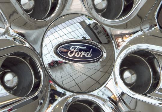 Ford's net income fell 8 percent to $2.4 billion in the second quarter, partly because of higher prices for steel.